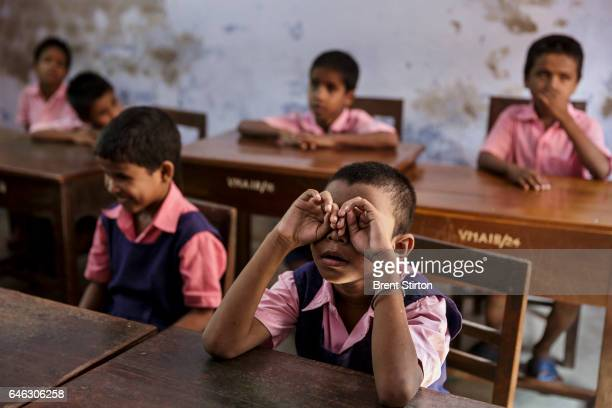 Blind children at the Vivekananda Mission Asram school for the blind across a busy street on their way to school This is the highest rated school for...