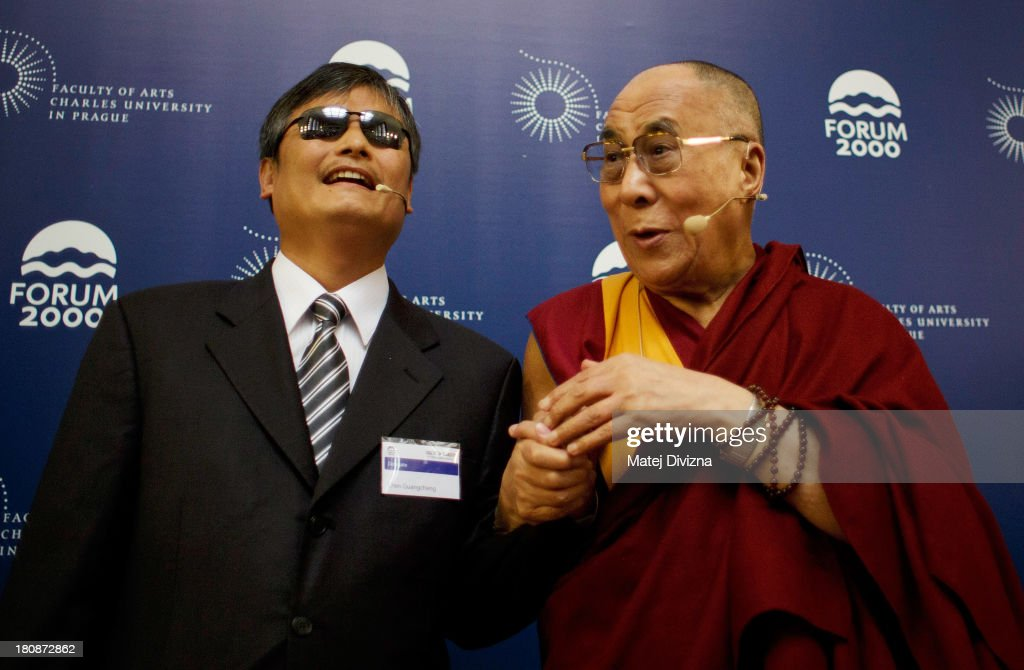Blind Chinese civil right activist Chen Guangcheng and Tibetan spiritual leader the Dalai Lama pose for photographers before the panel discussion...