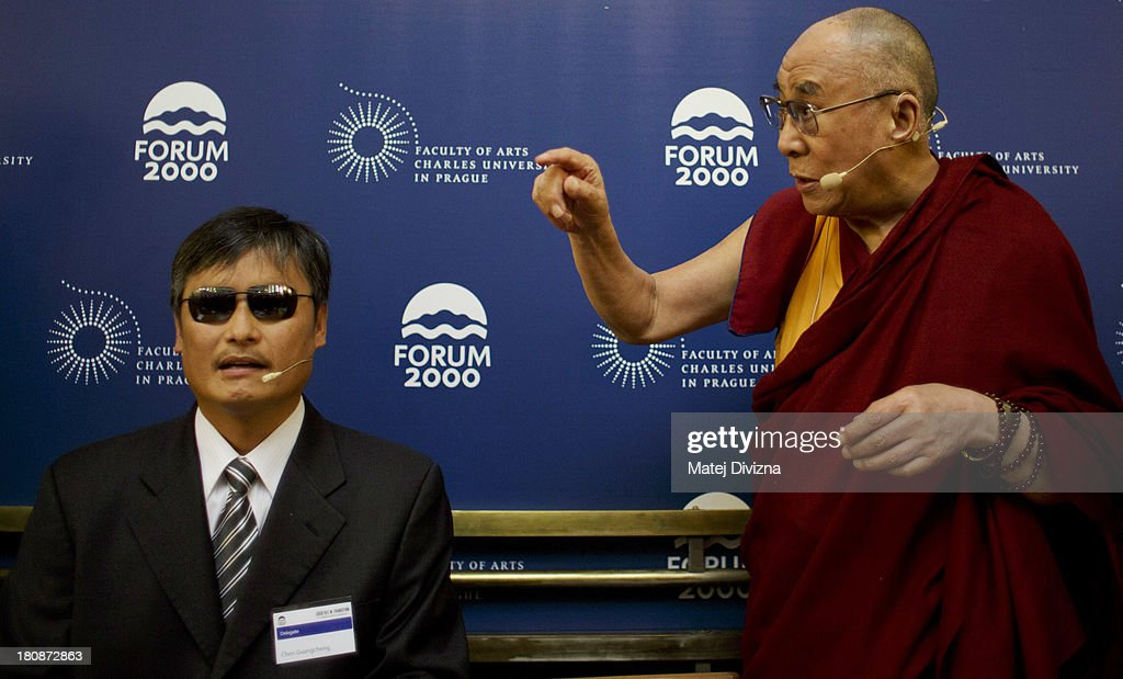 Blind Chinese civil right activist Chen Guangcheng and Tibetan spiritual leader the Dalai Lama attend the panel discussion during the 17th Forum 2000...