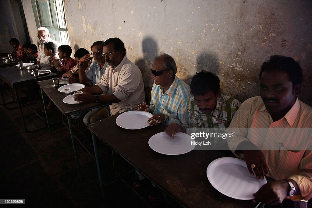 Blind helpers wait for lunch at the Government High School for The Blind on February 22, 2013 in Kadapa, India. The school which is funded by the government looks after 50 visually impaired or blind students. India has the largest number of people with visual impairment globally. According to the World Health Organization (WHO), an estimated 63 million people in India are visually impaired, and of these approximately 8 million people are blind.