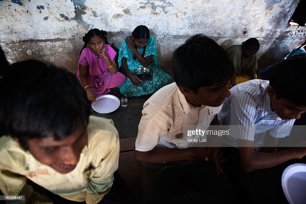 Blind helpers wait for lunch at the Government High School for The Blind on February 22, 2013 in Kadapa, India. It is still a cultural norm for females to sit on the floor while males sit at tables during meals. The school which is funded by the government looks after 50 visually impaired or blind students. India has the largest number of people with visual impairment globally. According to the World Health Organization (WHO), an estimated 63 million people in India are visually impaired, and of these approximately 8 million people are blind.
