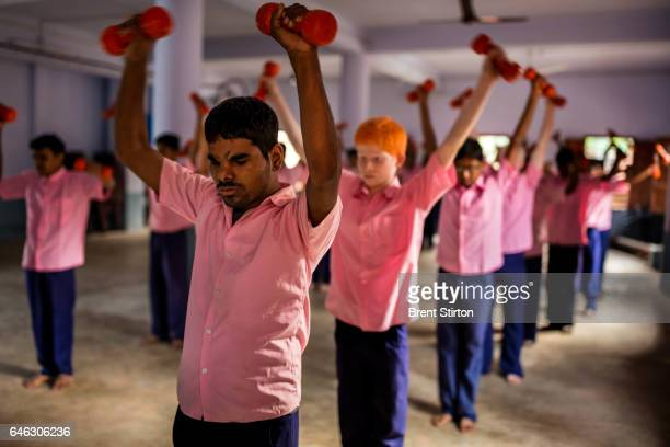 Blind male students of the Vivekananda Mission Asram school for the blind are seen at their calisthenics and yoga class in the main assembly hall...
