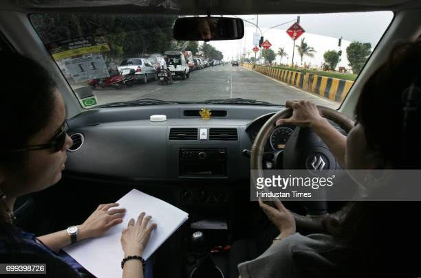 Blind Man Car Rally Lata Navigator helps her partner for route at fourth Blind Man's Car Rally Bombay Round Table 2 held in Worli Mumbai on Sunday