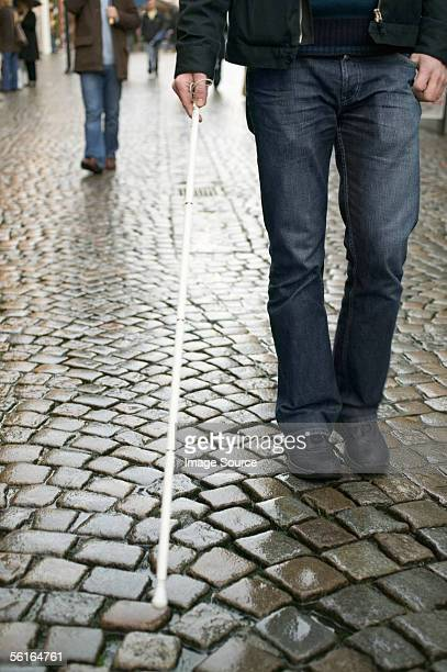 Blind man using a cane