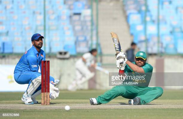 Blind Pakistani cricket batsman Nisar Ali plays a shot during the T20 World Cup for the Blind event at the Feroz Shah Kotla Stadium in New Delhi on...