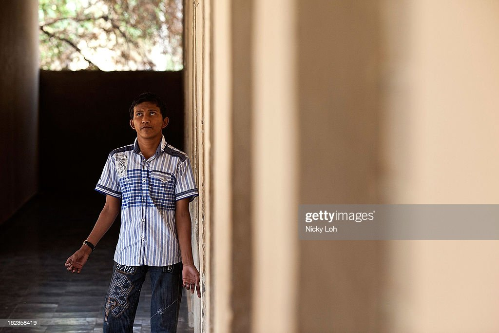 A blind student walks along the corridor of the Government High School for The Blind on February 22, 2013 in Kadapa, India. The school which is funded by the government looks after 50 visually impaired or blind students. India has the largest number of people with visual impairment globally. According to the World Health Organization (WHO), an estimated 63 million people in India are visually impaired, and of these approximately 8 million people are blind.