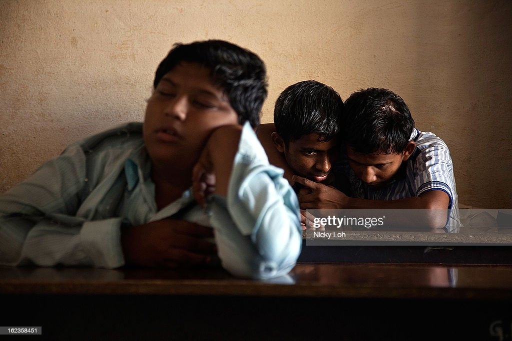 Blind students attend a lesson at the Government High School for The Blind on February 22, 2013 in Kadapa, India. The school which is funded by the government looks after 50 visually impaired or blind students. India has the largest number of people with visual impairment globally. According to the World Health Organization (WHO), an estimated 63 million people in India are visually impaired, and of these approximately 8 million people are blind.