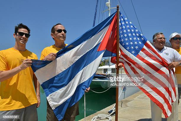 Blind US athlete Peter Crowley and his son Peter Crowley Jr pose with the Cuban and US flags at the Marina Hemingway in Havana on April 25 2014...