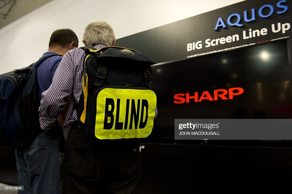 A blind visitor walks past an Aquos flat screen TV at the stand of Japanese electronics giant Sharp, during the 52nd edition of the IFA (Internationale Funkausstellung) electronics trade fair in Berlin on September 3, 2012. IFA, Europe's largest consumer electronics and home appliances fair opens to the public from August 31 to September 5, 2012, with more than 1,400 exhibitors taking part.