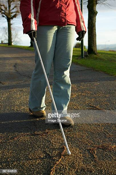 Blind woman using a cane