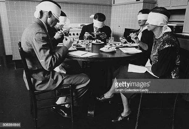 Blindfolded focus group in mock kitchen taste testing meats at the Department of Agriculture Beltsville Maryland Maryland 1935 From the New York...