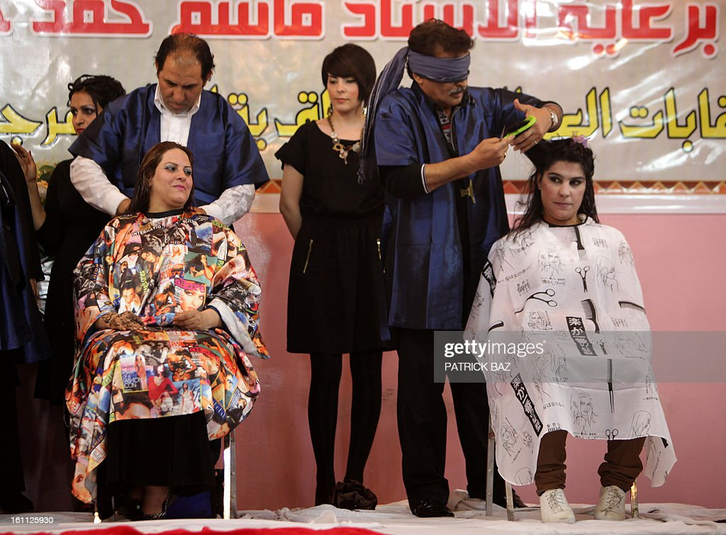 A blindfolded Iraqi hairdresser (R) competes on stage during a hairdressers and make up artists festival on February 9, 2013 in Baghdad. It is the first time that this kind of festival takes place in the Iraqi capital since 1999.