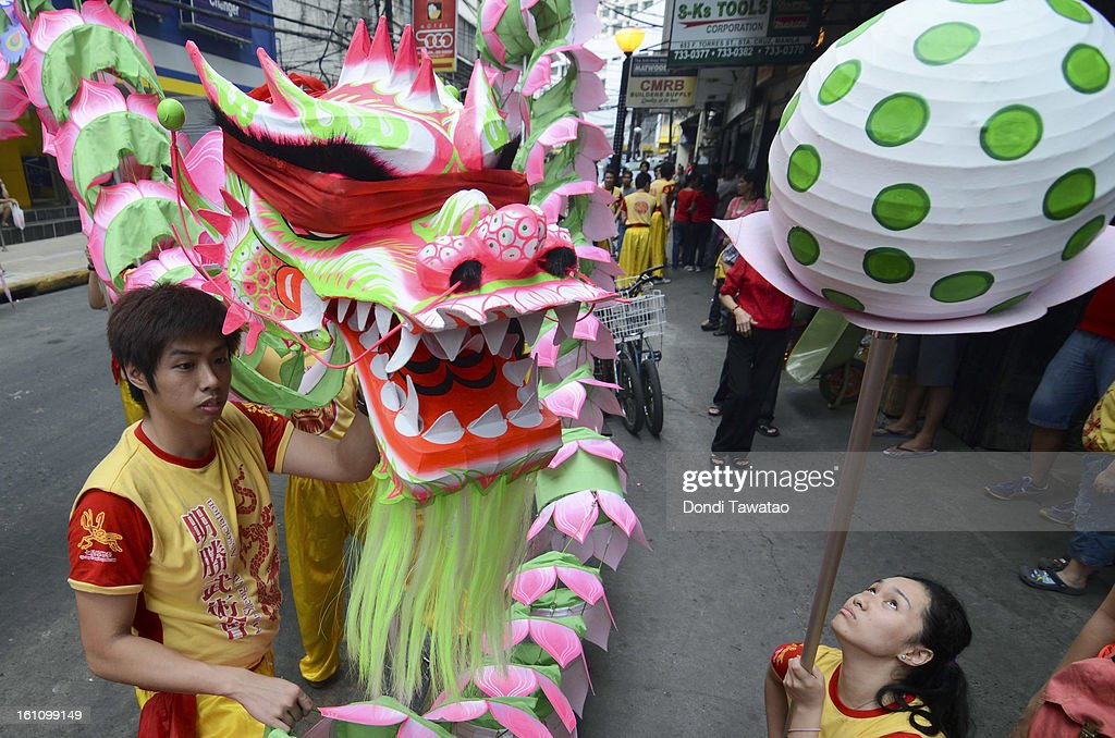 A blindfolded lotus dragon waits to be blessed by elders during the celebration of the Chinese New Year in the district of Binondo on February 9, 2013 in Manila, Philippines. Only after being fitted with eyelids can a dragon 'come to life', according to traditional Chinese dragon clans. The Chinese New Year begins tomorrow and this year is the year of the snake, known by locals as 'Spring Festival' or 'Lunar New Year' it is celebrated annually by Chinese Filipinos who make up roughly 20 percent of the local population.