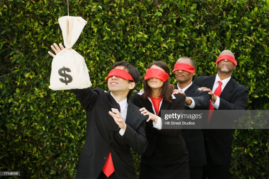 Blindfolded multi-ethnic businesspeople reaching for money : Stock Photo