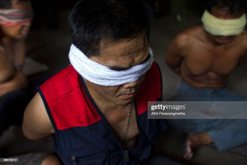 Blindfolded Red-shirt protesters are detained by Thai security forces inside their encampment on May 19, 2010 in Bangkok, Thailand. Protesters have clashed with military forces for six consecutive days in Bangkok after the government launched an operation to disperse anti-government protesters who have closed parts of the city for more than two months. Despite calls from the United Nations for both sides to begin talks, anti-government protesters in Bangkok have defied orders to leave their fortified camp, with 37 people having died and more than 260 injured since the military began its crackdown.