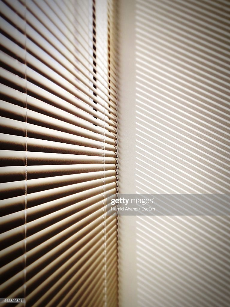 Blinds Casting Striped Shadow