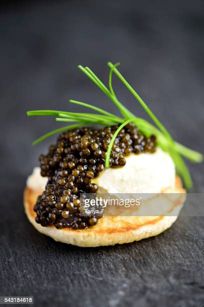 Blini with Sour Cream and Real Black Caviar