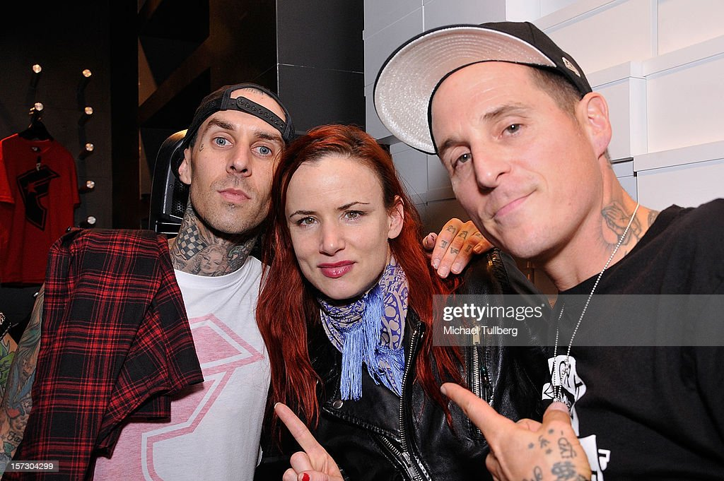 Blink 182 drummer Travis Barker, actress Juliette Lewis and musician Toby Morse attend the launching of the One Life One Chance web store on December 1, 2012 in Los Angeles, California.