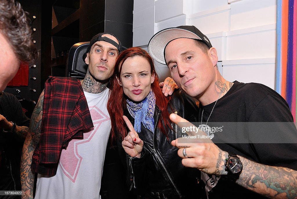 Blink 182 drummer <a gi-track='captionPersonalityLinkClicked' href=/galleries/search?phrase=Travis+Barker&family=editorial&specificpeople=213206 ng-click='$event.stopPropagation()'>Travis Barker</a>, actress <a gi-track='captionPersonalityLinkClicked' href=/galleries/search?phrase=Juliette+Lewis&family=editorial&specificpeople=202873 ng-click='$event.stopPropagation()'>Juliette Lewis</a> and musician Toby Morse attend the launching of the One Life One Chance web store on December 1, 2012 in Los Angeles, California.