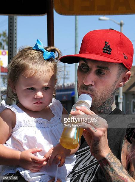 Blink182 drummer Travis Barker and his daughter Alabama wait at a valet stand on W 3rd Street July 29 2007 in Los Angeles California