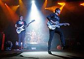 Blink182 singer/bassist Mark Hoppus drummer Travis Barker and singer/guitarist Tom DeLonge perform during the first show of the band's reunion tour...