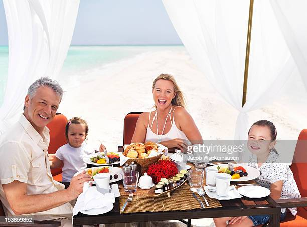 Blissful family in paradise
