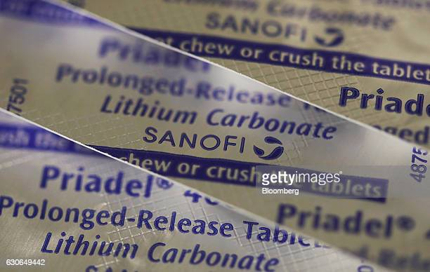 Blister packs containing Priadel tablets produced by Sanofi sit on a pharmacy counter in this arranged photograph in London UK on Thursday Dec 29...
