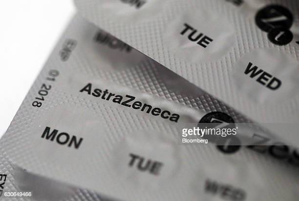 Blister packs containing Zestoretic diuretic tablets produced by AstraZeneca Plc sit on a pharmacy counter in this arranged photograph in London UK...