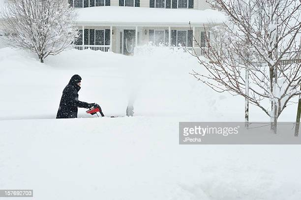 Blizzard Snow, Man using Snowblower