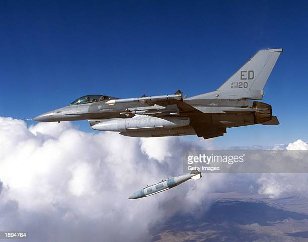 Block 30 F16 from the 416th Flight Test Squadron drops a Joint Direct Attack Munition during testing in January 2003 at Edwards Air Force Base in...