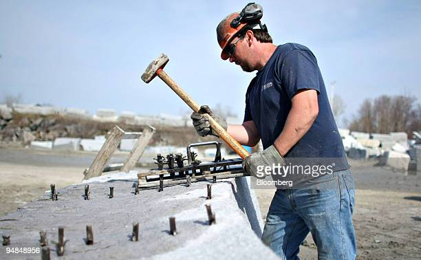 A block of granite is prepared for splitting outside a Rock of Ages Corp quarry in Graniteville Vermont US on Tuesday April 22 2008 Rock of Ages Corp...