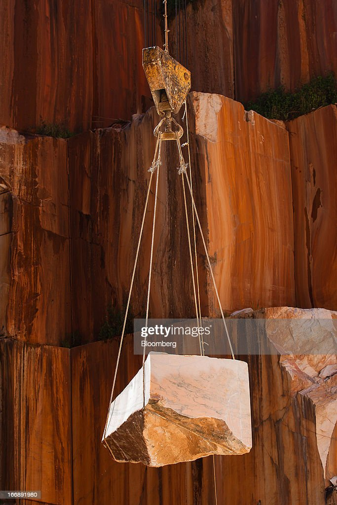 A block of marble is hoisted by crane from the gallery of a quarry pit operated by Bloco B in Bencatel, Vila Vicosa, Portugal, on Wednesday, April 17, 2013. Portugal is posting its first trade surplus in at least six decades, which may help vindicate a strategy of front-loading austerity to deliver economic reform. Photographer: Mario Proenca/Bloomberg via Getty Images