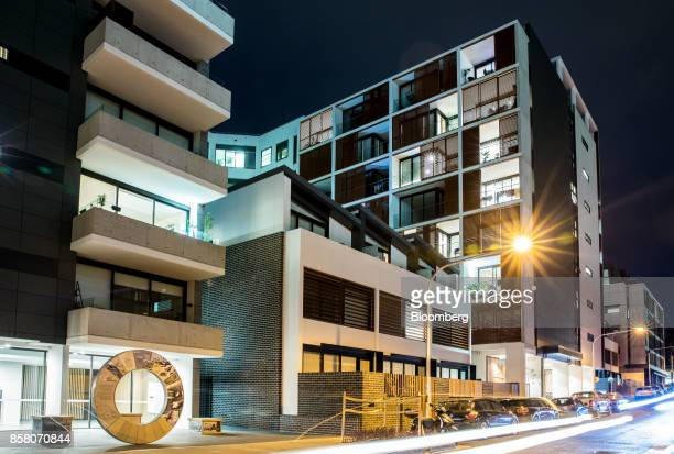 A block of residential apartments stands illuminated at night in Sydney Australia on Friday Sept 29 2017 A bungled transition from coal to clean...
