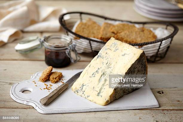 Block of stilton cheese, bread, jam