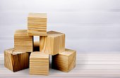Wooden cubes on table background