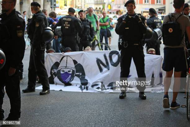 MARIENPLATZ MUNICH BAVARIA GERMANY Blockade stopping Pegida for a moment Today around 50 people joined the racist Pegida march in Munich Police took...
