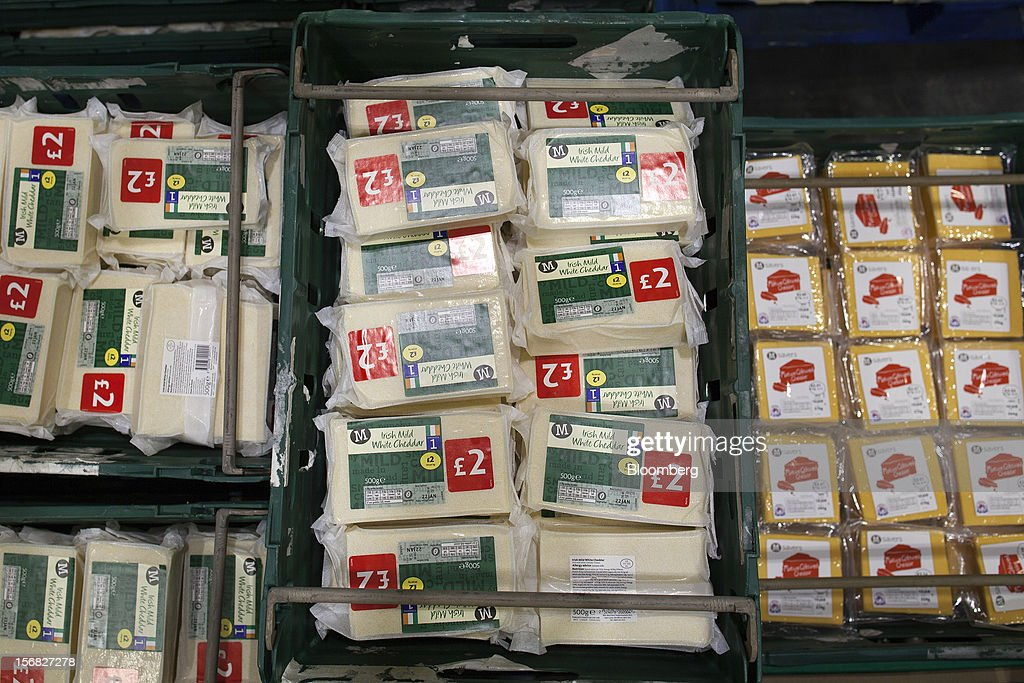 Blocks of cheese sit in storage boxes at WM Morrison Supermarkets Plc's distribution center in Wakefield, U.K., on Thursday, Nov. 22, 2012. Britain's economy will return to growth next year after stagnating in 2012, with expansion weighted in the second half, according to Bank of England projections published yesterday. Photographer: Simon Dawson/Bloomberg via Getty Images
