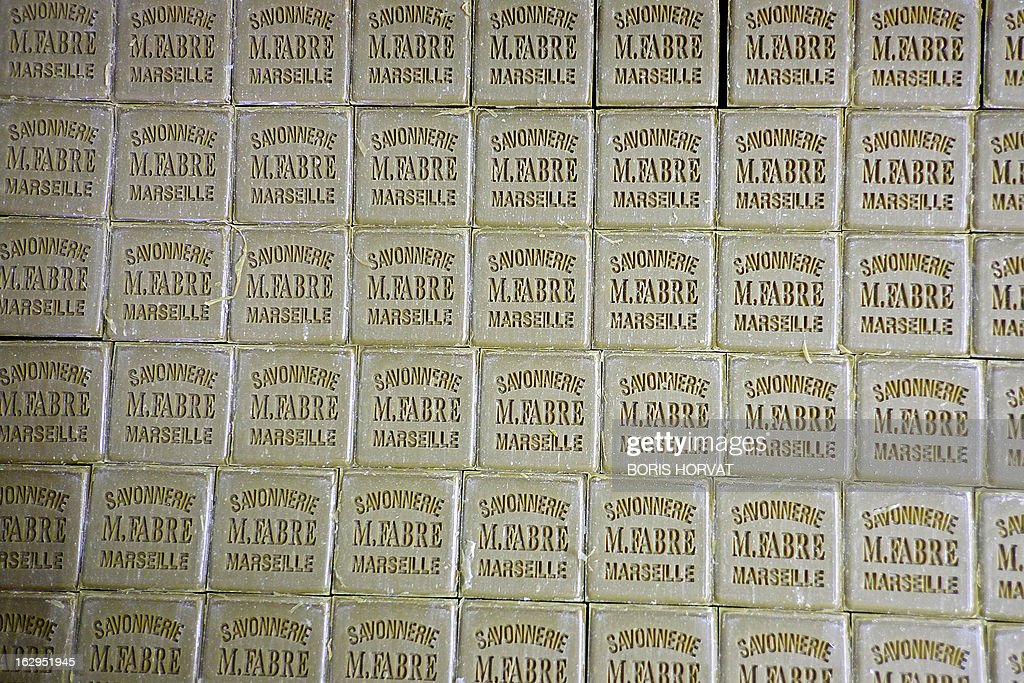 Blocks of Marseille Soap (Savon de Marseille) are seen on February 26, 2013 in Salon-de-Provence, southern France. The four remaining Marseille soap-makers, who estimate that their product is too often victim to unfair competition by inathentenic products, are cleaning up the market to defend their product, firstly with a collective brand, and soon, they hope, with a 'geographic indication'. 'There is more fake Marseille soap being sold than real' claims Julie Bousquet-Fabre, the president of the Union of professionals of Marseille soap (UPSM). AFP PHOTO / BORIS HORVAT