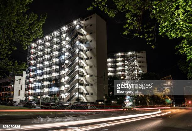 Blocks of residential apartments stand illuminated at night in Sydney Australia on Friday Sept 29 2017 A bungled transition from coal to clean energy...