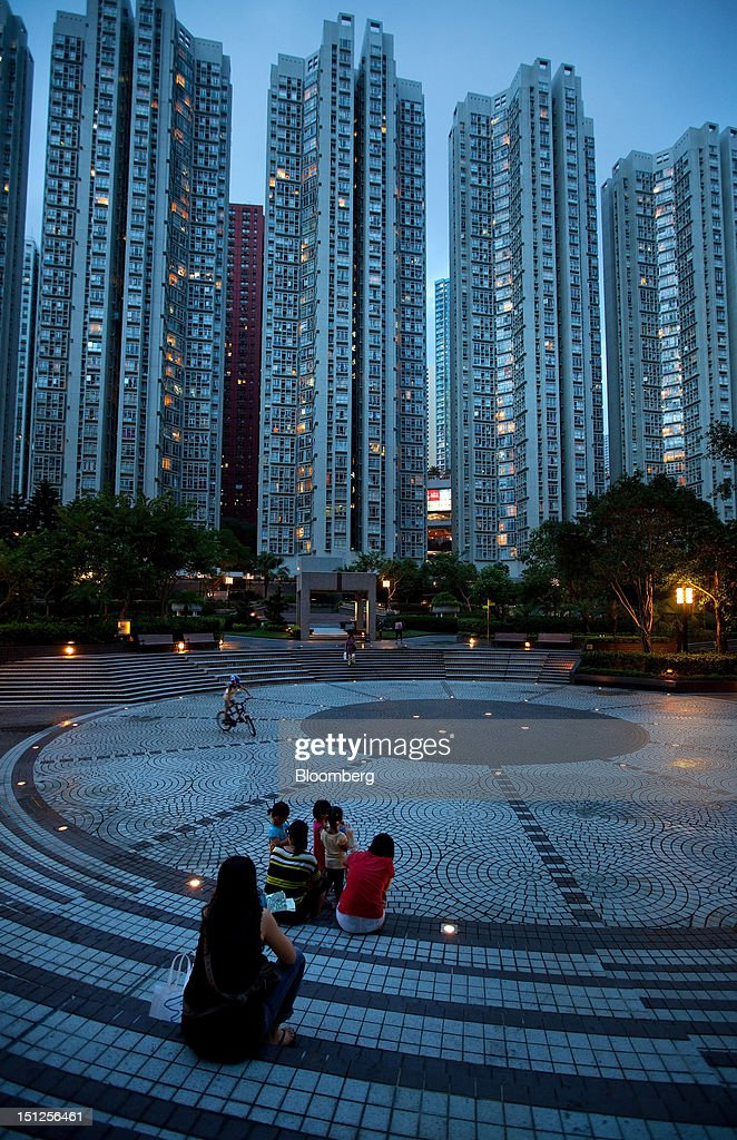 Blocks of Sceneway Garden housing estate apartments stand in the Lam Tin area of Hong Kong, China, on Tuesday, Sept. 4, 2012. Hong Kong will boost the supply of homes and give preference to local buyers as it seeks to cool housing prices that have surged to the world's most expensive, fueled by record-low interest rates and Chinese investment. Photographer: Daniel J. Groshong/Bloomberg via Getty Images