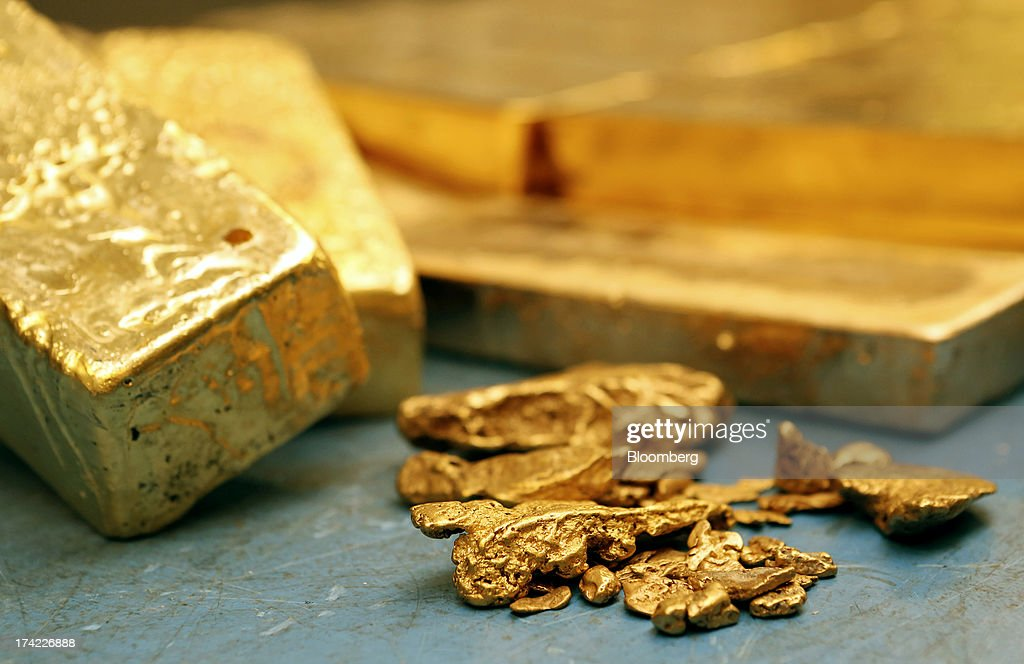 Blocks of unrefined gold bars and gold nuggets wait to be processed at the precious metals refinery plant of Italpreziosi SpA in Arezzo, Italy, on Friday, July 19, 2013. Hedge funds raised bets on a gold rally before prices capped the biggest two-week gain in 20 months as Federal Reserve Chairman Ben S. Bernanke damped speculation that a cut in stimulus is imminent. Photographer: Alessia Pierdomenico/Bloomberg via Getty Images