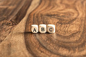 ABC building blocks on wooden background