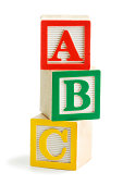 """Subject: The alphabets A, B, C, stacked with wooden alphabet toy blocks."""