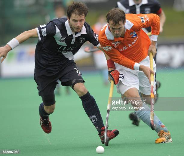Bloemendaal's Eby Kessing challenges Lille's Valentin Migneau during their EuroHockey League Round 12 game at East Grinstead HC West Sussex