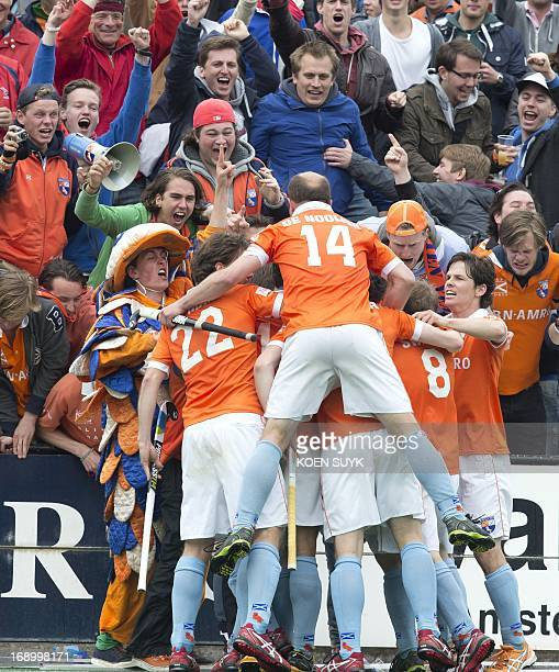 Bloemendaal's Teun de Nooijer celebrates with teammates after scoring a goal during the Euro Hockey League semifinal match against Amsterdam in...