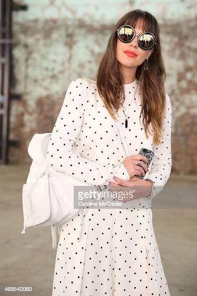 Blogger Ally Carey wearing a Bec Bridge dress Sunday Somewhere bag and sun glasses Samantha Wills accessories poses at MercedesBenz Fashion Week...