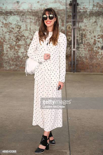Blogger Ally Carey wearing a Bec Bridge dress Sunday Somewhere bag and sun glasses Samantha Wills accessories poses at MercedesBenz Fashion Week...