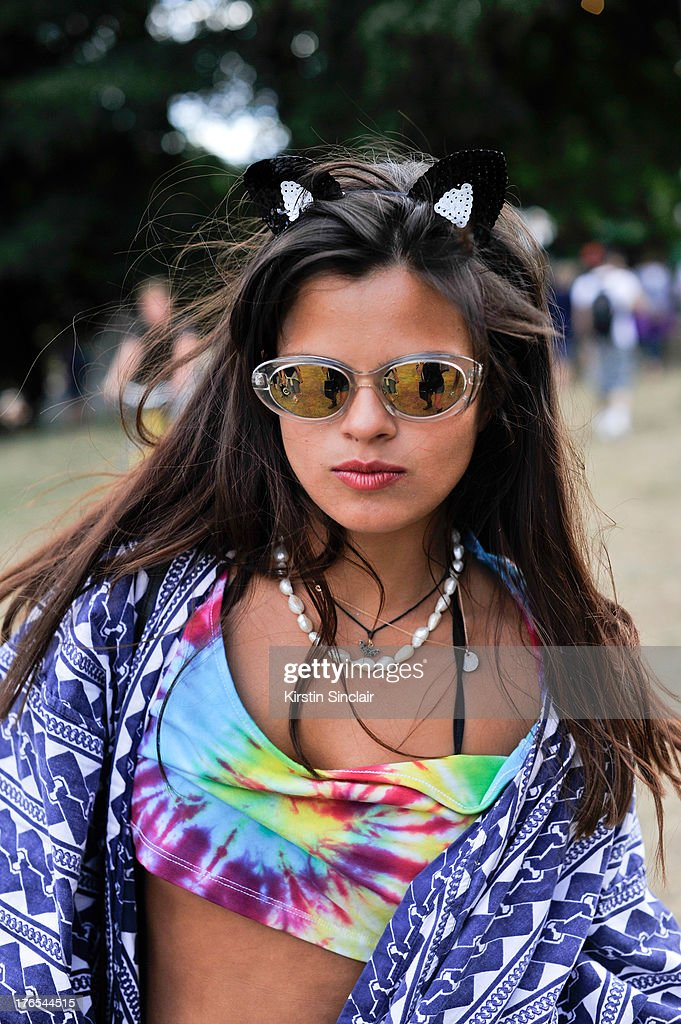 Blogger and DJ <a gi-track='captionPersonalityLinkClicked' href=/galleries/search?phrase=Bip+Ling&family=editorial&specificpeople=5953668 ng-click='$event.stopPropagation()'>Bip Ling</a> wears Adhoc cat ears, Raged Priest Top, Vintage sunglasses and a Japanese Kimono on day 4 of Wilderness Festival on August 11, 2013 in Cornbury Park, Oxfordshire, England.