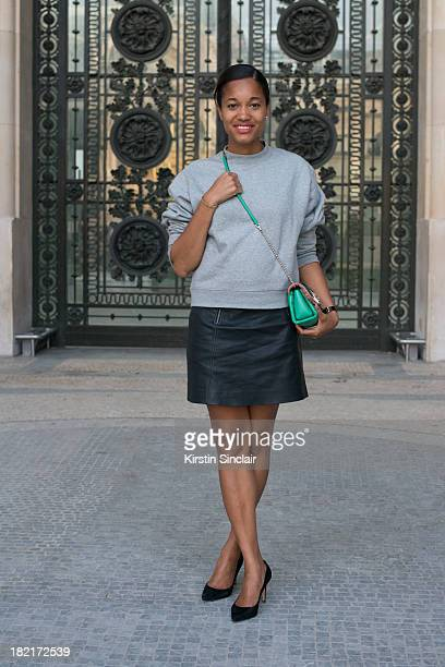 Blogger and fashion editor Tamu McPherson wears Gianvito Rossi shoes J Crew shirt Acne sweater and a Paula Cademartori bag on day 4 of Paris Fashion...