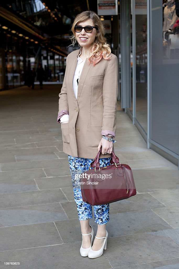 blogger and journalist Lauren Whitehead wearing Topshop shoes Mary Katrantzou trousers Chloe bag H and M jacket The Kooples shirt Ray Ban sunglasses...